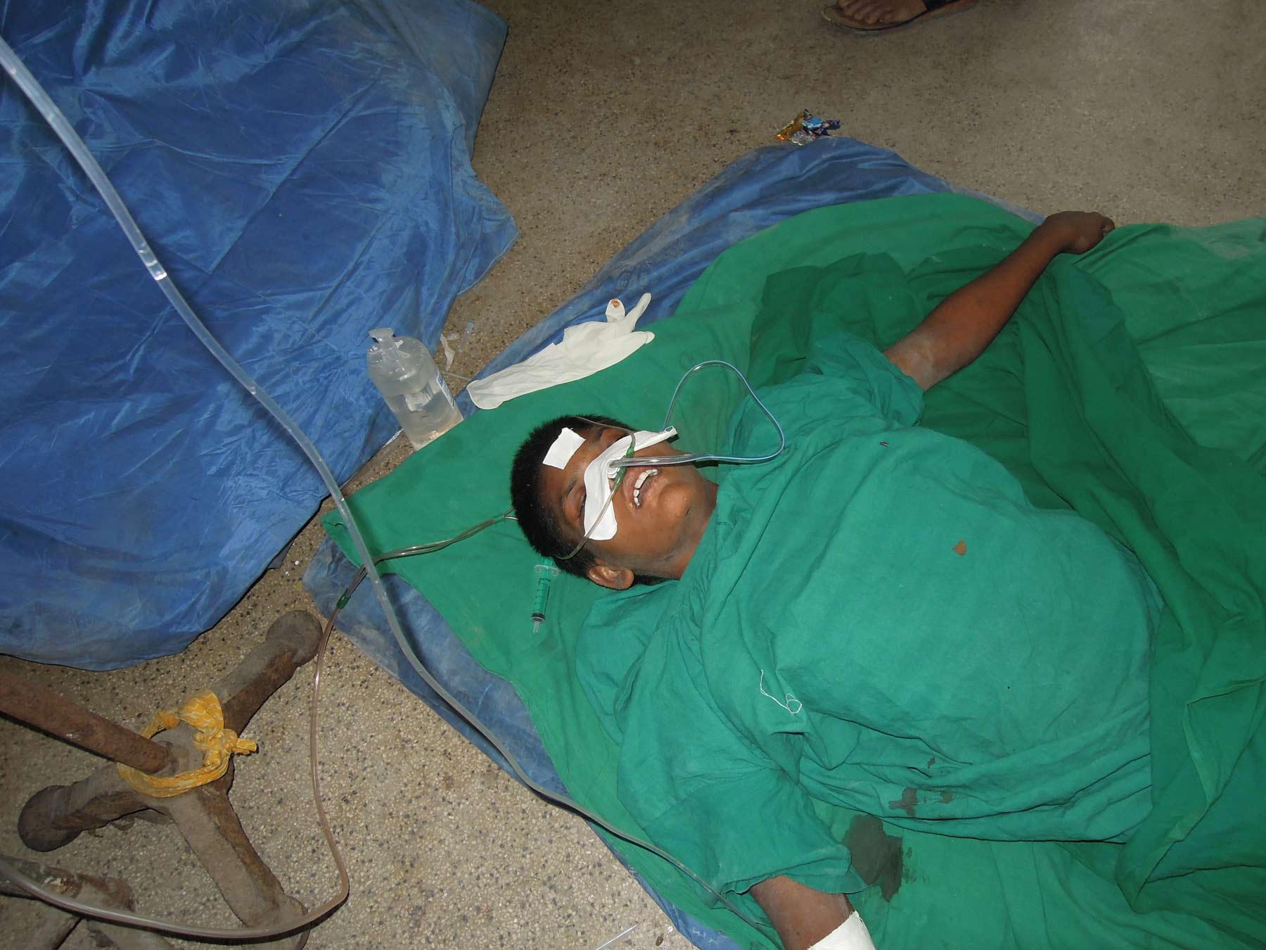 Unidentified patient receiving iv fluids on the floor of the hospital