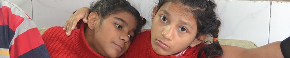 Two girls share their lives at Shishur Sevay